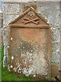NY6323 : Weathered gravestone, All Saints Church, Bolton by Karl and Ali