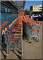 TQ2382 : Shopping trolleys, Ladbroke Grove Sainsbury's by Derek Harper