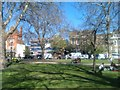 TQ2576 : Northern corner of Parsons Green in spring sunshine by David Martin