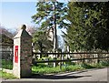 TL4150 : Harston: postbox, churchyard and tower by John Sutton