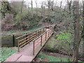 NY3757 : The footbridge over Boomby Gill by Ian S