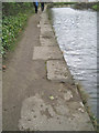 SK3687 : Unequal stone blocks edge the canal by Robin Stott