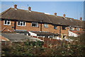 TQ5787 : Houses by the railway, Cranham by Nigel Chadwick