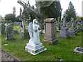 TQ3565 : Graves in St John the Evangelist Churchyard, Shirley by Ian Yarham