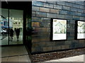 TQ8209 : Entrance and posters at the Jerwood Gallery, Hastings by pam fray