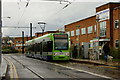 TQ3165 : Tram at Reeves Corner, Croydon by Peter Trimming