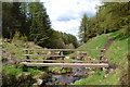 SK0172 : Footbridge over Deep Clough by Neil Theasby