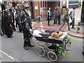 TQ8209 : Terrier in pram at Jack in the Green parade by Oast House Archive
