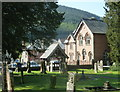 SO0571 : Churchyard and village scene, Abbeycwmhir by Andrew Hill