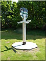 TF6628 : Wolferton village sign and fingerposts, Wolferton by pam fray