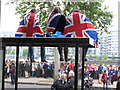 TQ2777 : Diamond Jubilee Pageant - flag-draped lads up on a bus stop by David Hawgood