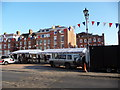 SO5174 : Ludlow market setting up in summer by Jeremy Bolwell