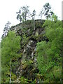 NH2627 : Rock outcrop above the Glen Affric road by Dave Fergusson
