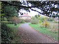 TL1706 : Along the path through the Hill End Hospital Cemetery, St Albans by Chris Reynolds