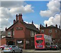 SJ9295 : Red Lion and Red Bus by Gerald England