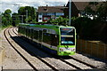 TQ2768 : Tram Approaching the Mitcham Tram Stop by Peter Trimming
