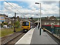 SK0394 : Train for Manchester at Glossop by Gerald England
