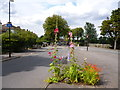 TQ3273 : Dulwich:  Road junction with flowers by Dr Neil Clifton