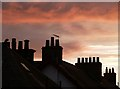 NT4936 : Silhouetted chimney pots by Walter Baxter