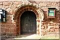SJ4350 : Norman Doorway in St Edith's Church, Shocklach by Jeff Buck
