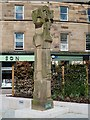 NT4936 : Man with a sheep statue in the Market Square, Galashiels by Walter Baxter