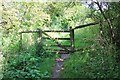 SP0512 : Gate across path near Chedworth by Terry Jacombs