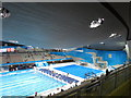TQ3884 : Inside the Olympics aquatics centre, view to finish and diving areas by David Hawgood