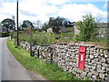 NY7017 : Village  Postbox by Martin Dawes