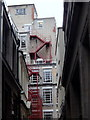 SP0686 : City buildings overlooking a small alley by Andrew Hill