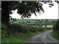 SP9098 : Down hill from Seaton by John Sutton