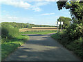 SP1212 : Eastington Road junction northeast of Trinder's Barn by Stuart Logan