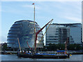 TQ3380 : Thames sailing barge passes City Hall by Graham Robson