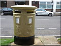 Dist:0.3km<br/>This double-aperture, Elizabeth II-reign postbox faces the former Cheam main post office in Ewell Road. It is painted gold in honour of cyclist Joanna Rowsell's gold medal at the 2012 Olympics.