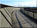 TL2398 : Woodwork and brickworks - The Millennium Bridge near Peterborough by Richard Humphrey
