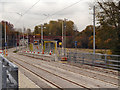 SJ8598 : Holt Town Tram Stop by David Dixon