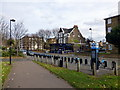 TQ3078 : London Cycle Hire Docking Station in Vauxhall Walk by PAUL FARMER