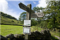 NY5704 : Sign post and Bridleway by Tom Richardson