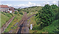 View eastward, on the ex-GSWR lines from Ayr (also Troon, ?goods only) towards Mauchline to the left and to the right via Drongan and Cumnock to Cronberry and Muirkirk. Passenger services on the Mauchline line ceased from 4/1/43, on the Drongan line from 10/9/51 and the station closed that day, but in 1994 both routes were still open for goods traffic - after interruption in the 1980s, mainly conveying open-cast coal.