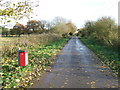 TL7471 : Dog Bin And Minor Road by Keith Evans