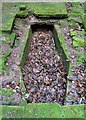 NT9250 : A kist inside Fishwick Mortuary Chapel by Walter Baxter
