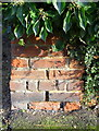 SP5108 : Benchmark on wall pier at #10 Chadlington Road by Roger Templeman