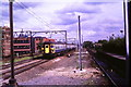 TQ5188 : Train approaching Romford by Malc McDonald