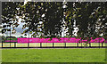SP2865 : London 2012 banners, Henry VIII all-weather pitch by Robin Stott