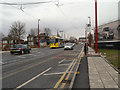 SJ9098 : Metrolink Tram on Manchester Road by David Dixon