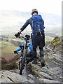 NY2926 : Cyclists on Lonscale Crags by Oliver Dixon