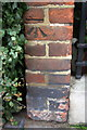 TQ2579 : Benchmark on wall of Hamston House, Kensington Court Place by Roger Templeman