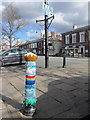 SJ5177 : A crocheted bollard cover in Main Street, Frodsham by John S Turner
