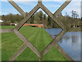 TL8425 : Through the diamond window, walled garden, Marks Hall Estate by Roger Jones