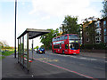TQ3876 : Bus stop at the top of Blackheath Hill by Stephen Craven