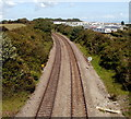 ST0766 : Railway passes Porthkerry Caravan Park by John Grayson